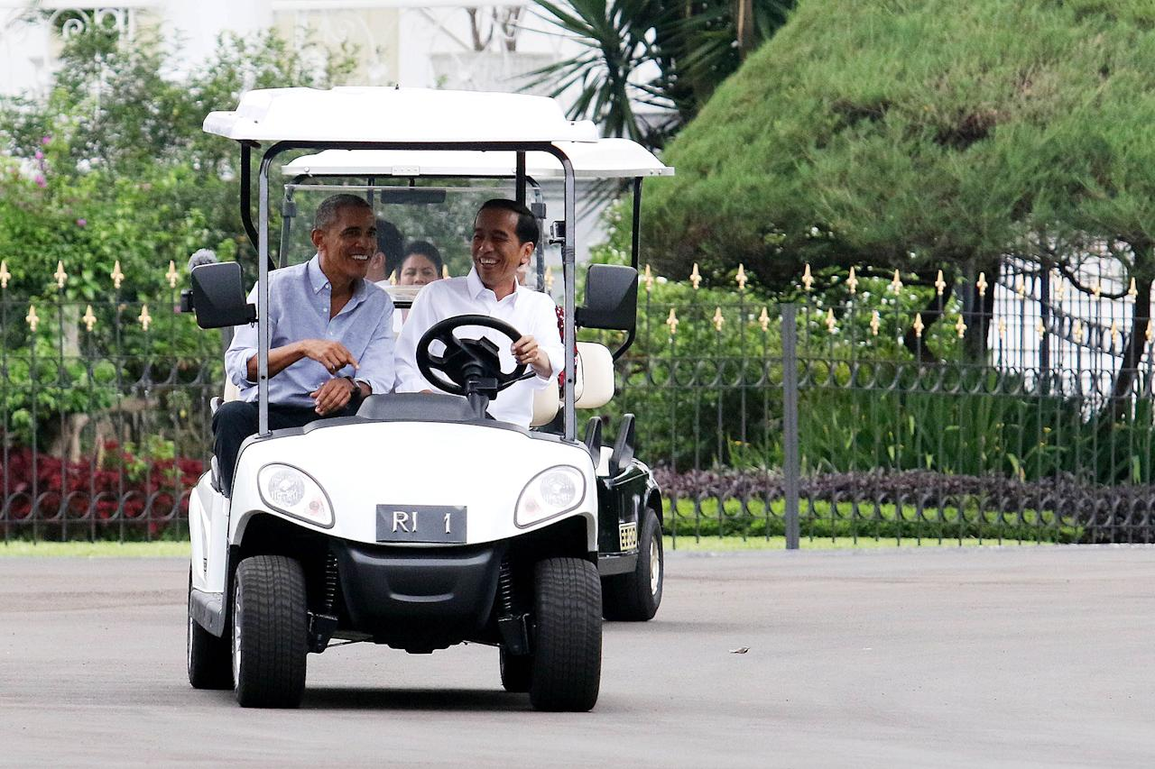 <p>Barack Obama and his family are in the middle of an adventure-filled, nine-day vacation to Indonesia, where the former president lived for several years as a child. Their latest stop is Bogor Presidential Palace in West Java, where the former president and his family were invited to stay by Indonesian President Joko Widodo.  In this photo, President Widodo is seen taking Obama on a golf-cart tour of the palace's grounds. </p>