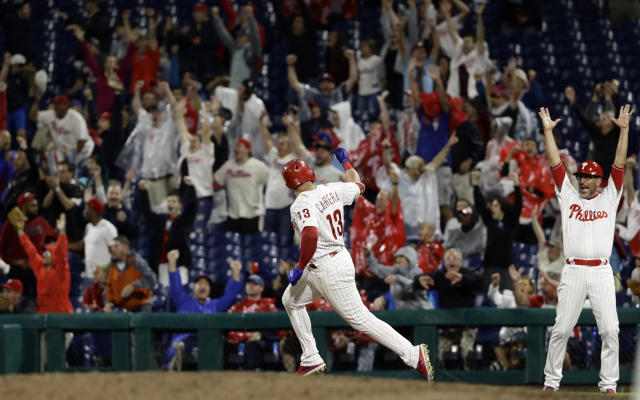 Philadelphia Phillies' Asdrubal Cabrera (13) celebrates after hitting the game-winning home run off Chicago Cubs relief pitcher Steve Cishek during the 10th inning of a baseball game, Friday, Aug. 31, 2018, in Philadelphia. Philadelphia won 2-1. (AP Photo/Matt Slocum)