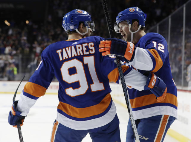 "<a class=""link rapid-noclick-resp"" href=""/nhl/teams/nyi/"" data-ylk=""slk:New York Islanders"">New York Islanders</a> right wing <a class=""link rapid-noclick-resp"" href=""/nhl/players/4482/"" data-ylk=""slk:Josh Bailey"">Josh Bailey</a> (12) celebrates with teammate <a class=""link rapid-noclick-resp"" href=""/nhl/players/4681/"" data-ylk=""slk:John Tavares"">John Tavares</a> (91) after scoring the game winning goal  Wednesday. (AP Photo/Frank Franklin II)"