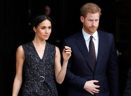 Britain's Prince Harry and his fiancee Meghan Markle leave a service at St Martin-in-The Fields to mark 25 years since Stephen Lawrence was killed in a racially motivated attack, in London, Britain, April 23, 2018. REUTERS/Peter Nicholls