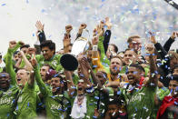 The Seattle Sounders celebrate after winning the MLS Cup soccer match 3-1 over Toronto FC, Sunday, Nov. 10, 2019, in Seattle. (Genna Martin/seattlepi.com via AP)