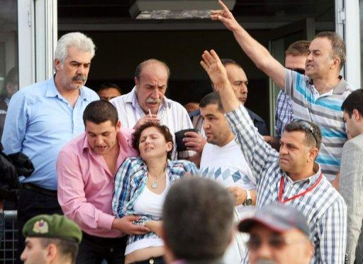Relatives of Turkish soldiers react after a court decision in Silivri in the two-year-long coup trial