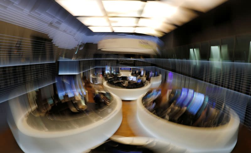 FILE PHOTO: The trading floor is seen at the end of a trading day at the German stock exchange (Deutsche Boerse) in Frankfurt