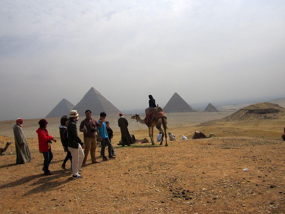 """An Egyptian sunrise at Giza<br><br><b>ABOUT THE PHOTOGRAPHER</b><br><br> <p><img style="""""""" src=""""http://l.yimg.com/t/images/svetlana-baghawan-80.jpg""""><b>SVETLANA BAGHAWAN</b> worked for 13 years as a flight attendant, a job that gave her the opportunity to travel and explore places close to her heart and of her dreams. Now blessed with a four-year-old daughter, she runs a beauty salon and spa in Kolkata but her restless traveler's spirit never leaves her alone. Thanks to her supportive husband and family, she backpacks as a single woman traveler all over the world at least four times a year, mostly with her four-year-old budding traveler in tow.</p>"""