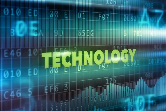 "The word ""technology"" on top of computing codes"