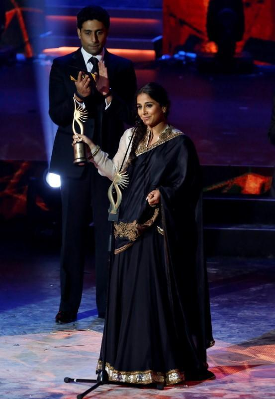 FILE PHOTO: Vidya Balan smiles after receiving an award for the best performance in a leading role at the 14th annual IIFA awards show in Macau