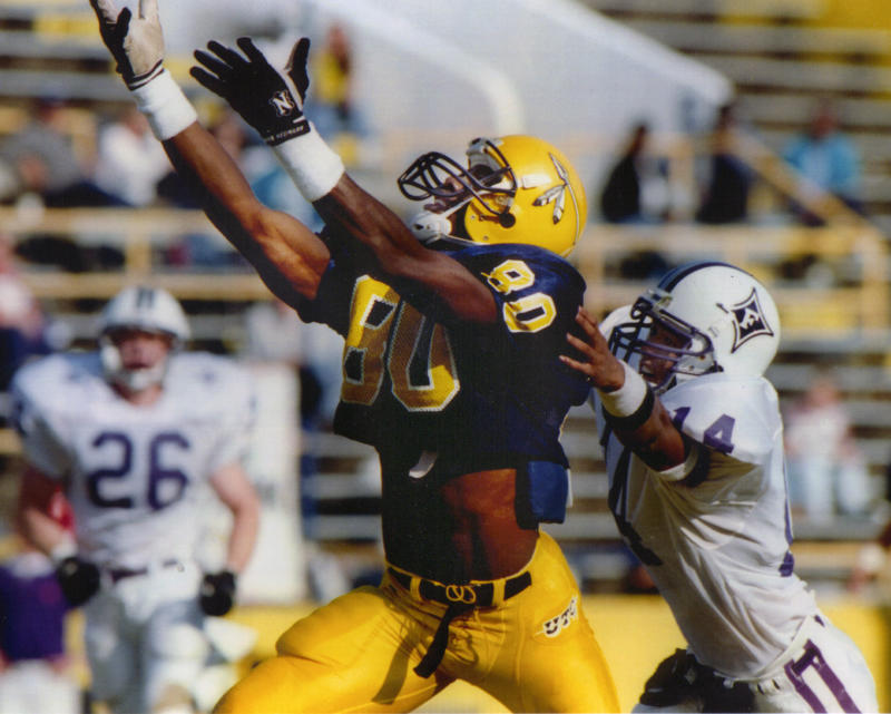 Terrell Owens (80) is paying homage to his alma mater at the University of Tennessee at Chattanooga. (UTC Athletics via AP)