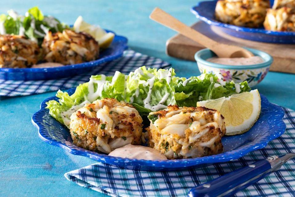 """<p>Make these juicy crab cakes right in your own home with our tutorial. (P.S. You can even turn this app into a main course by serving the cakes over a salad or placing them on a bun.)</p><p><strong><a href=""""https://www.thepioneerwoman.com/food-cooking/recipes/a36202143/crab-cakes-recipe/"""" rel=""""nofollow noopener"""" target=""""_blank"""" data-ylk=""""slk:Get the recipe"""" class=""""link rapid-noclick-resp"""">Get the recipe</a>.</strong></p><p><a class=""""link rapid-noclick-resp"""" href=""""https://go.redirectingat.com?id=74968X1596630&url=https%3A%2F%2Fwww.walmart.com%2Fbrowse%2Fhome%2Fthe-pioneer-woman-dishes%2F4044_623679_639999_7373615&sref=https%3A%2F%2Fwww.thepioneerwoman.com%2Ffood-cooking%2Fmeals-menus%2Fg32157273%2Ffourth-of-july-appetizers%2F"""" rel=""""nofollow noopener"""" target=""""_blank"""" data-ylk=""""slk:SHOP PLATES"""">SHOP PLATES</a></p>"""