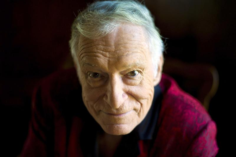FILE - In this Oct. 13, 2011 file photo, American magazine publisher, founder and Chief Creative Officer of Playboy Enterprises, Hugh Hefner poses at his home at the Playboy Mansion in Beverly Hills, Calif.  (AP Photo/Kristian Dowling, File)