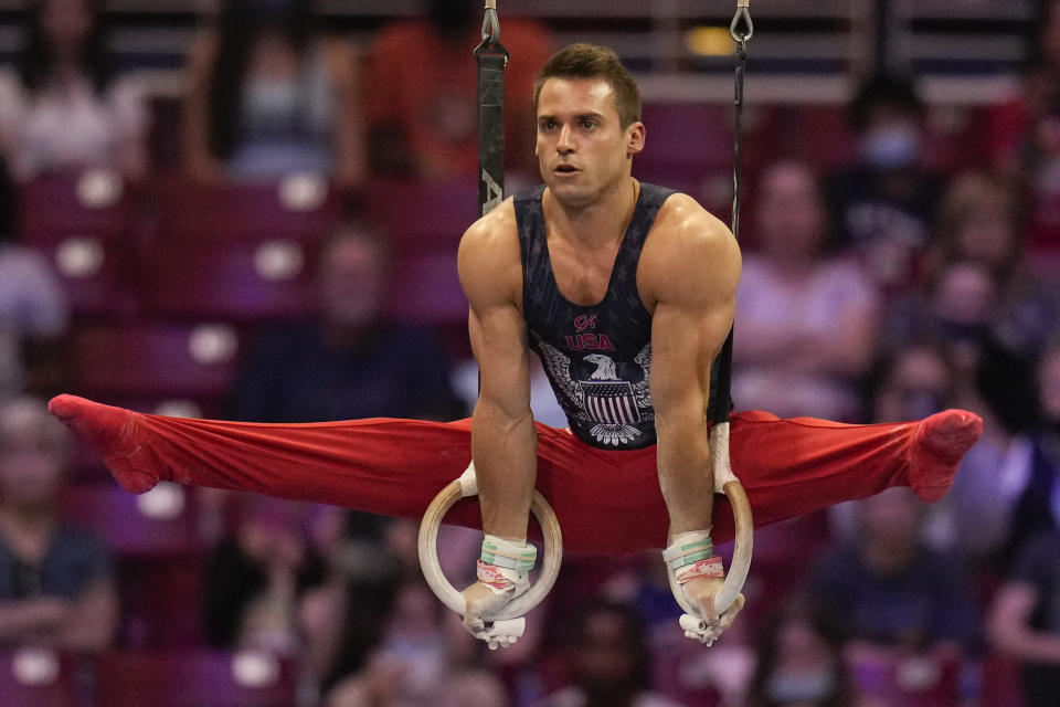 Sam Mikulak competes on the still rings during the men's U.S. Olympic Gymnastics Trials Saturday, June 26, 2021, in St. Louis. (AP Photo/Jeff Roberson)
