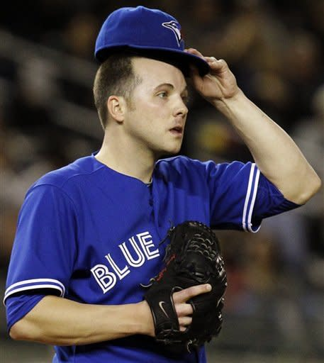 Toronto Blue Jays starting pitcher Aaron Laffey adjusts his cap in the fourth inning of their baseball game against the New York Yankees at Yankee Stadium in New York, Thursday, Sept. 20, 2012. (AP Photo/Kathy Willens)
