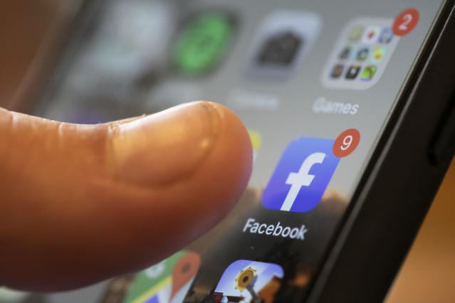 An iPhone displays the Facebook app in New Orleans. (AP Photo/Jeny Kane)