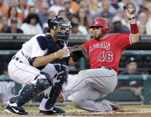 Los Angeles Angels' Bobby Wilson (46) beats the throw to score against Detroit Tigers catcher Alex Avila, left, in the third inning of of a baseball game Saturday, Aug. 25, 2012, in Detroit. (AP Photo/Duane Burleson)