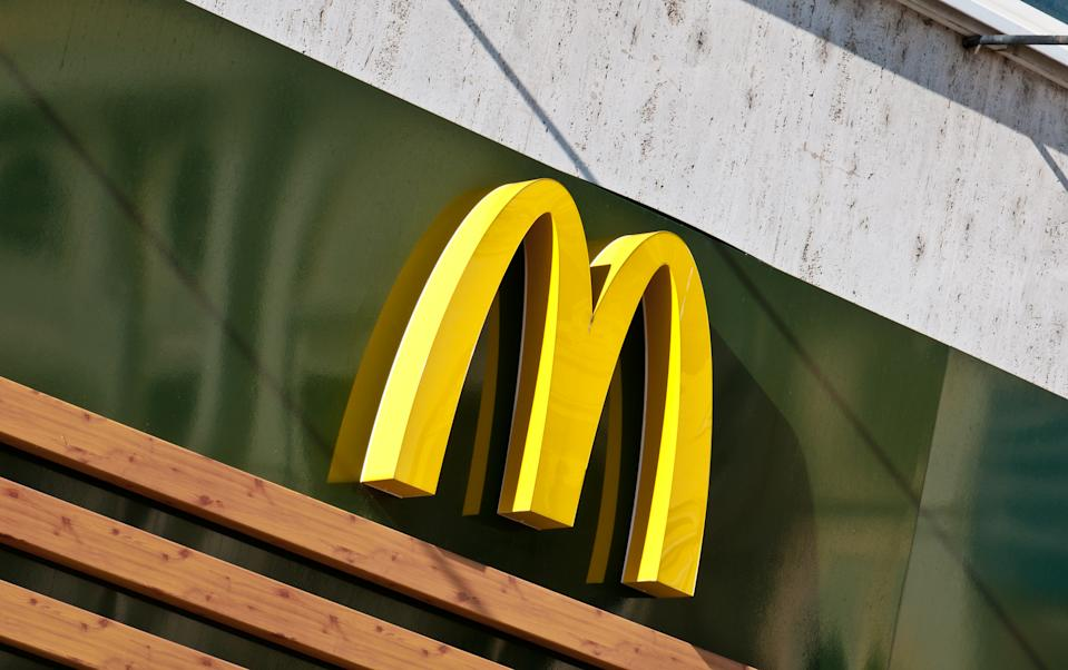 Bratislava, Slovakia - October 2, 2011: McDonald's Golden Arches Logo from a Mc Cafè store in central square of Bratislava, capital of Slovakia. This food chain entered in Eastern European countries just after the fall of Berlin Wall in 1989