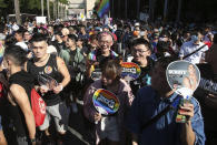 Participants march through a street during a pride parade in Taipei, Taiwan, Saturday, Oct. 31, 2020. (AP Photo/Chiang Ying-ying)