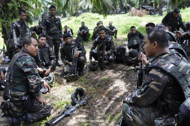 This photo, taken on March 14, 2013 and released by the Malaysia Ministry of Defence, shows Malaysian soldiers preparing for an operation in the area of Sungai Nyamuk where Filipino gunmen were locked down in a stand-off in the surrounding villages of Tanduo, in Sabah