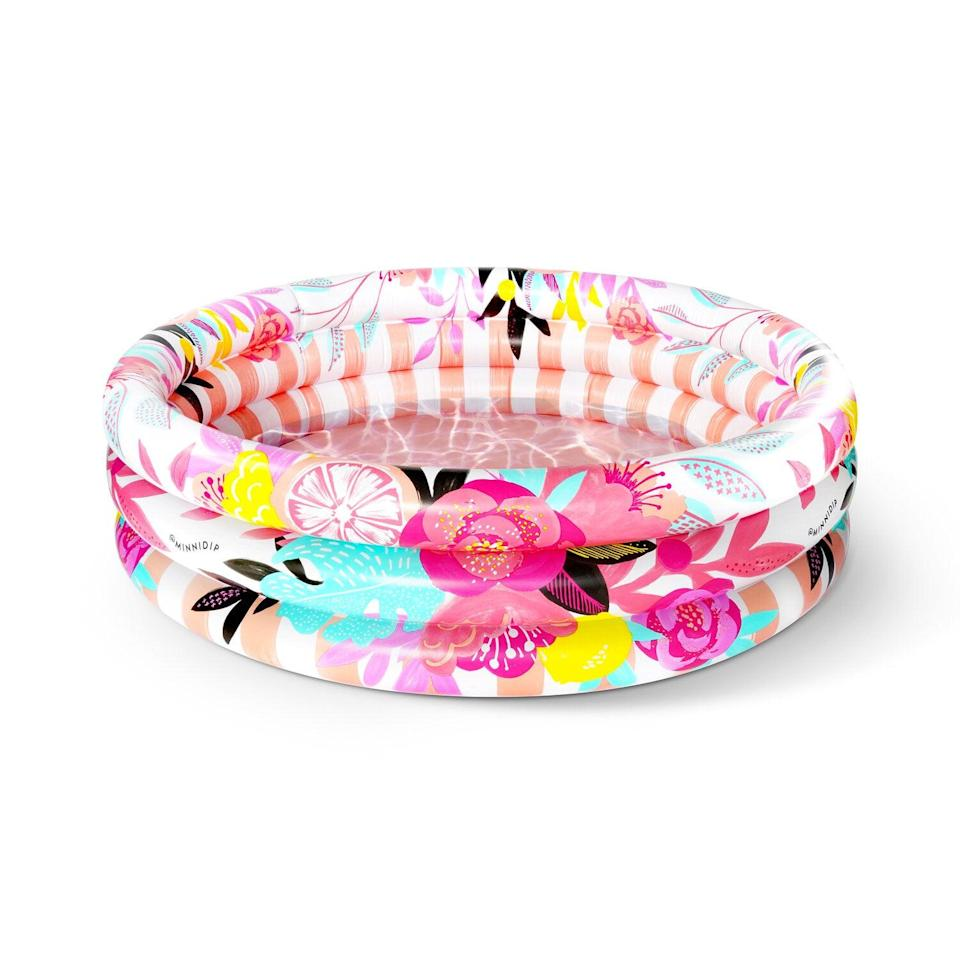 "<p>Take a dip in the floral-filled <a href=""https://www.popsugar.com/buy/Stop-Smell-Ros%C3%A9-Luxe-Inflatable-Pool-585136?p_name=The%20Stop%20and%20Smell%20the%20Ros%C3%A9%20Luxe%20Inflatable%20Pool&retailer=minnidip.com&pid=585136&price=45&evar1=tres%3Aus&evar9=44816431&evar98=https%3A%2F%2Fwww.popsugar.com%2Fphoto-gallery%2F44816431%2Fimage%2F47576674%2FStop-Smell-Ros%C3%A9-Luxe-Inflatable-Pool&list1=pools%2Csummer%2Cnostalgia&prop13=api&pdata=1"" class=""link rapid-noclick-resp"" rel=""nofollow noopener"" target=""_blank"" data-ylk=""slk:The Stop and Smell the Rosé Luxe Inflatable Pool"">The Stop and Smell the Rosé Luxe Inflatable Pool</a> ($45). This pool will restock at the end of June. </p>"