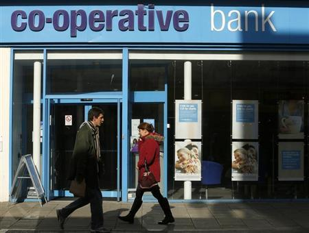 People pass a Co-operative Bank in Brighton in southern England February 26, 2014. REUTERS/Luke MacGregor