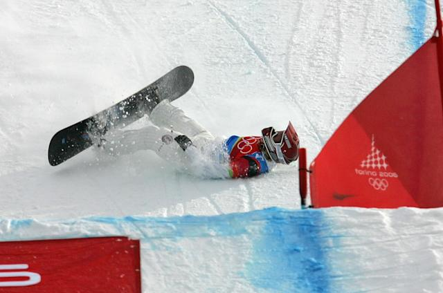 American Lindsey Jacobellis who was leading in the final of the Women's Snowboard Cross competition, crashes in sight of the finish at the Turin 2006 Winter Olympic Games in Bardonecchia, Italy, Friday, Feb. 17, 2006. Tanja Frieden of Switzerland won the race to take the gold medal, Jacobellis finished second to take the silver medal, and Dominique Maltais of Canada bronze. (AP Photo/Lionel Cironneau)