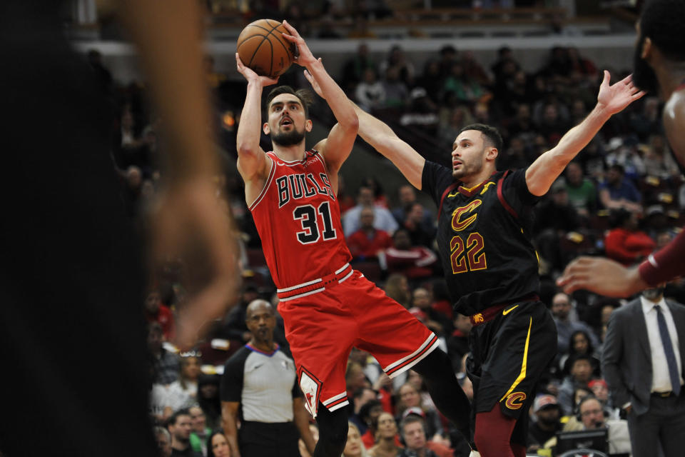 Chicago Bulls' Tomas Satoransky (31) goes up for a shot against Cleveland Cavaliers' Larry Nance Jr. (22) during the second half of an NBA basketball game Tuesday, March 10, 2020, in Chicago. (AP Photo/Paul Beaty)