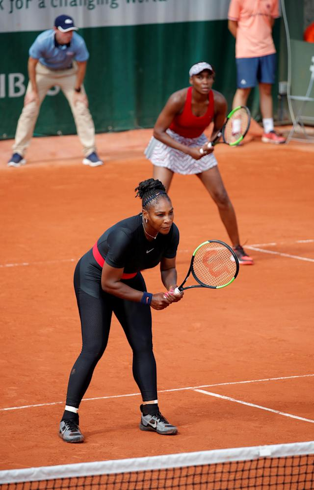 Serena and Venus Williams during their first doubles Grand Slam appearance in two years. (Reuters)