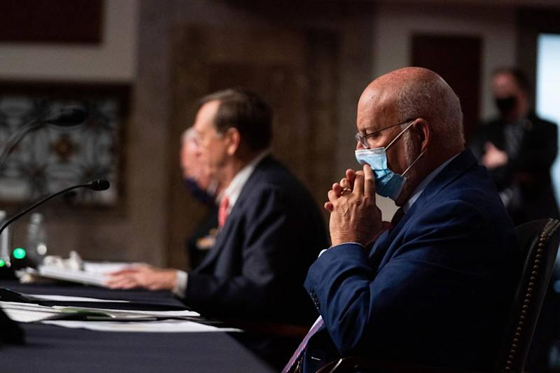 Masks may do more than a vaccine to protect against COVID-19, CDC director says