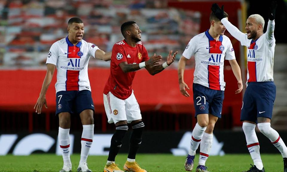 Manchester United's Fred (centre) reacts after he is sent off in the second half.