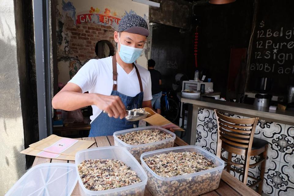 Ong Leng Hin packing the freshly made muesli. — Picture by Steven Ooi KE