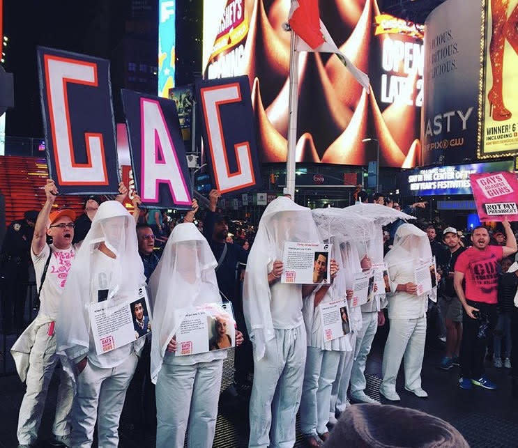More than 100 Gays Against Guns (GAG) protesters marched from New York's Union Square to Times Square Monday in honor of the 59 people killed in Sunday's mass shooting in Las Vegas.