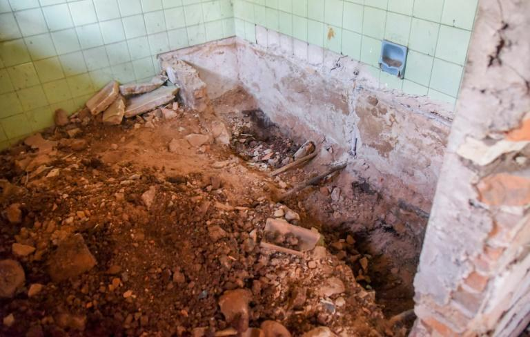 The bathroom where three skulls and other human remains were found