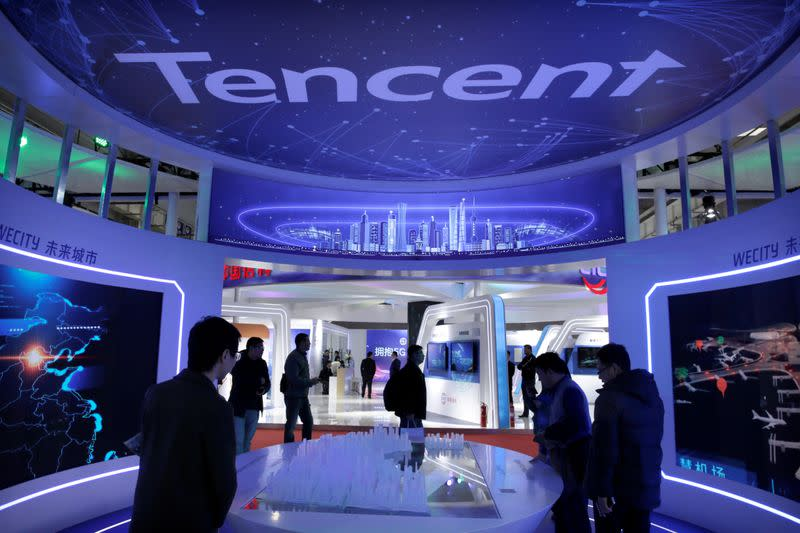 FILE PHOTO: People visit Tencent's booth at the World 5G Exhibition in Beijing