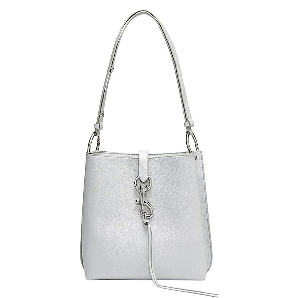 "<p><strong>Rebecca Minkoff</strong></p><p>amazon.com</p><p><strong>$246.42</strong></p><p><a href=""https://www.amazon.com/dp/B07KJJD7VJ?tag=syn-yahoo-20&ascsubtag=%5Bartid%7C10049.g.34329922%5Bsrc%7Cyahoo-us"" rel=""nofollow noopener"" target=""_blank"" data-ylk=""slk:Shop Now"" class=""link rapid-noclick-resp"">Shop Now</a></p><p>This sleek shoulder bag has a streamlined silhouette, but also ample room for anything else you may need to bring, so this purse means business. </p>"