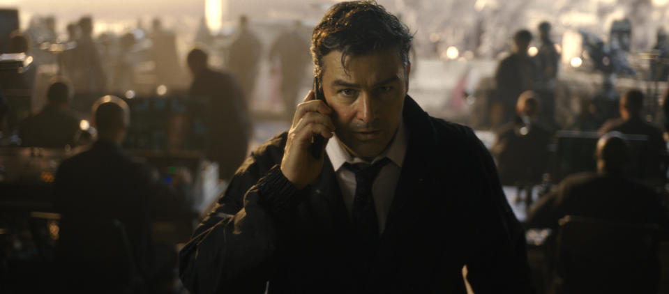 """This image released by Warner Bros. Entertainment shows Kyle Chandler in a scene from """"Godzilla vs. Kong."""" (Warner Bros. Entertainment via AP)"""