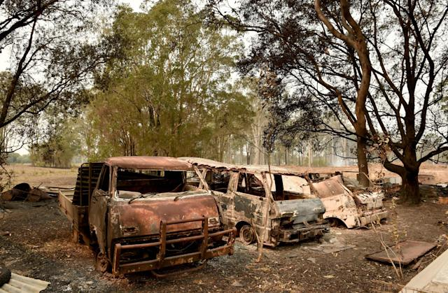 "The burnt-out remains of cars and property belonging to Art Murphy and his wife Shirley are seen following bushfires in Old Bar, 350km north of Sydney on November 11, 2019. A state of emergency on November 11 was declared and residents in the Sydney area were warned of ""catastrophic"" fire danger as Australia girded for a fresh wave of deadly bushfires that have ravaged the drought-stricken east of the country. (Photo by PETER PARKS / AFP) (Photo by PETER PARKS/AFP via Getty Images)"