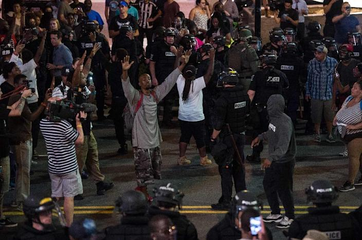 North Carolina Governor Pat McCrory declared a state of emergency after a second night of violence in Charlotte (AFP Photo/Nicholas Kamm)