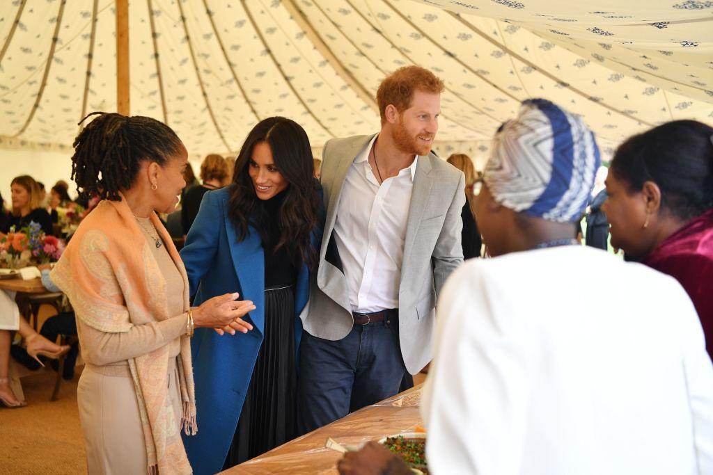 "<p>The royal couple was joined by Meghan's mother, Doria Ragland, during the launch of her <a rel=""nofollow"" href=""https://www.townandcountrymag.com/style/fashion-trends/a23322795/meghan-markle-together-cookbook-launch-outfit-blue-smythe-coat/"">new cookbook</a> named <em>Together. </em></p>"