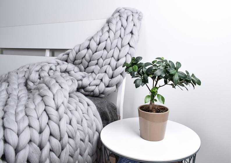 <p>This ultra-cozy <span>Chunky Knit Blanket</span> ($18 and up, originally $31 and up) will be her new movie-night buddy! It comes in a variety of colors and sizes.</p>