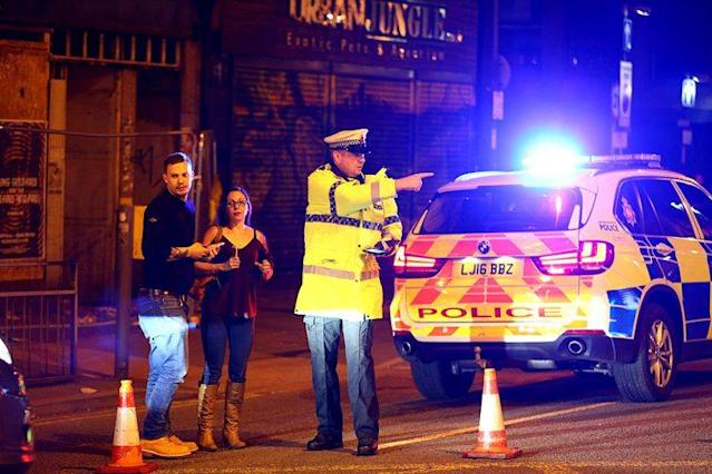 Police respond at a cordoned off street close to the Manchester Arena on May 22, 2017, after reports of explosions at an Ariana Grande concert. (Photo: Dave Thompson/Getty Images)