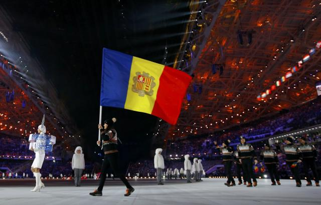 Andorra's flag-bearer Mireia Gutierrez leads her country's contingent during the opening ceremony of the 2014 Sochi Winter Olympic Games February 7, 2014. REUTERS/Brian Snyder (RUSSIA - Tags: SPORT OLYMPICS)