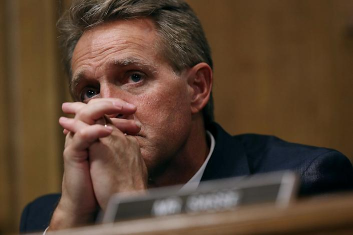 Sen. Jeff Flake listens to Christine Blasey Ford on Thursday. (Photo: Win McNamee/Reuters)