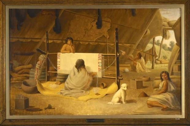 In this 1856 painting by Paul Kane, a Coast Salish woman from Vancouver Island is depicted weaving a blanket. Next to her is a depiction of a Salish woolly dog, once a beloved pet in many Salish communities. (Royal Ontario Museum - image credit)
