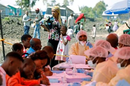 FILE PHOTO: A woman and child wait to receive the Ebola vaccination in Goma