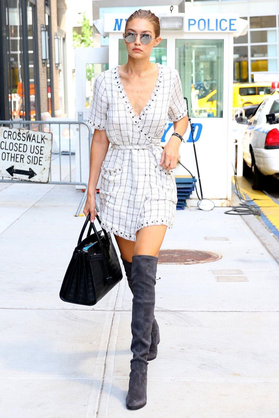 <p>The model spent Labor Day in Manhattan wearing a windowpane-checked romper with gray over-the-knee boots from Stuart Weitzman and black crocodile leather bag by Saint Laurent.</p>