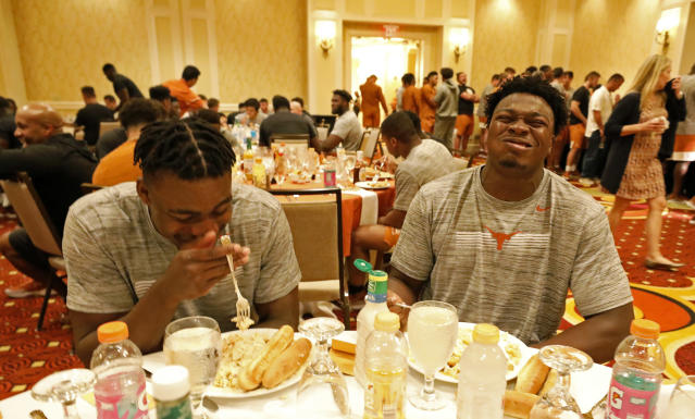 Texas Longhorns' Joseph Ossai (left) and Jeff McCulloch joke during dinner, Friday Sept. 6, 2019 at the team hotel in Austin, Tx. ( Photo by Edward A. Ornelas )