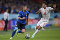 Italy's Marco Verratti, left, takes on Spain's Mikel Oyarzabal during the Euro 2020 soccer semifinal match between Italy and Spain at Wembley stadium in London, Tuesday, July 6, 2021. (Laurence Griffiths, Pool via AP)