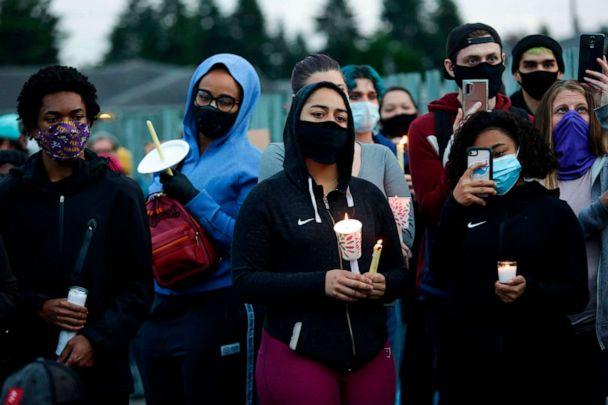 PHOTO: Family, friends and community members attend a vigil at the intersection where Manuel Ellis, a 33-year-old black man, died in Tacoma Police custody on March 3, 2020. (Jason Redmond/AFP via Getty Images)