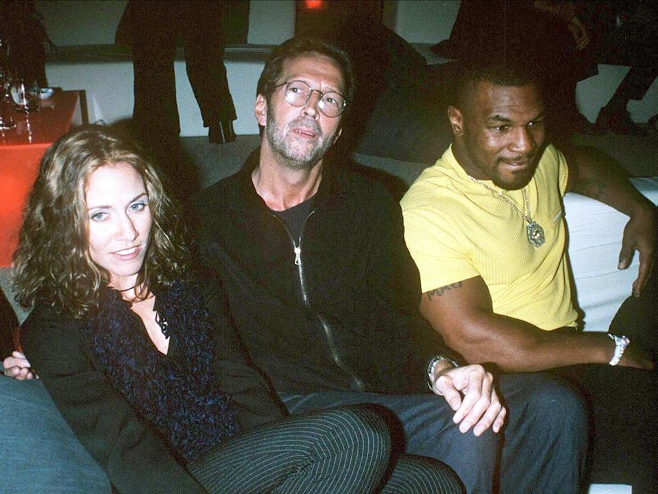 Sheryl Crow with Eric Clapton and Mike Tyson in New York, 1996 (Startraks/Shutterstock)