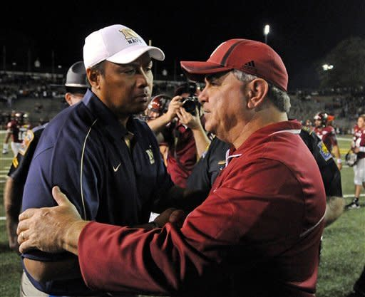 Navy head coach Ken Niumatalolo,left, and Troy head coach Larry Blakeney shake hands after an NCAA college football game in Troy, Ala., Saturday, Nov. 10, 2012. Troy won 41-31. (AP Photo/The (Troy)