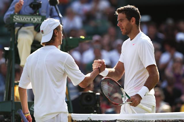 LONDON, ENGLAND - JULY 01: Juan Martin Del Potro of Argentina shakes hands at the net with Andreas Seppi of Italy after their Gentlemen's Singles fourth round match on day seven of the Wimbledon Lawn Tennis Championships at the All England Lawn Tennis and Croquet Club on July 1, 2013 in London, England. (Photo by Clive Brunskill/Getty Images)