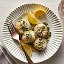 <p>A quick and impressive dinner, scallops turn succulent and tender in the air fryer. The lemon-herb sauce is the perfect way to bring zest to each bite. Be sure to cook the scallops to temperature. They may not brown in the fryer, so don't wait for a golden crust to tell you they're ready.</p>